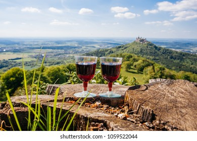Two glasses of red wine on picnic, nature view