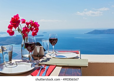 Two glasses of red wine on the table, overlooking the volcano of Santorini
