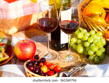 Two glasses of the red wine, picnic theme. Summer time.