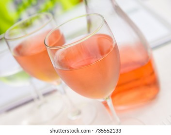 Two glasses of rose wine and on table