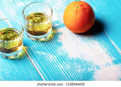 two glasses of rum and orange, a drink for two and an appetizer