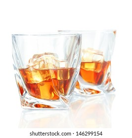 Two glasses of scotch whiskey, isolated on white