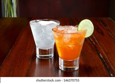 Two glasses of soft drink on wooden table