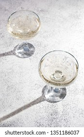 Two glasses with sparkling wine on the table. Celebration and holiday concept.