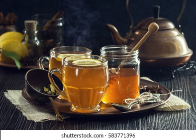 Two Glasses of Steaming Hot Lemon Spiced Tea or Hot Toddies for a Cold Winter's Day