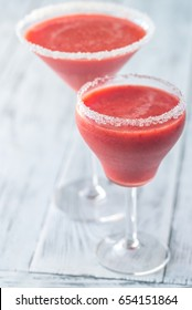 Two glasses of strawberry margarita cocktail