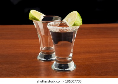 two glasses of tequila, salt and lime