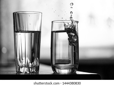 Two glasses of water and a splash