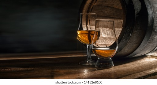 Two glasses with whiskey. They are for professional tasting dist