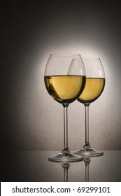 Two glasses of white wine close up