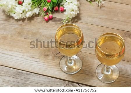 Two glasses white wine flowers closeup stock photo edit now two glasses of white wine and flowers closeup mightylinksfo