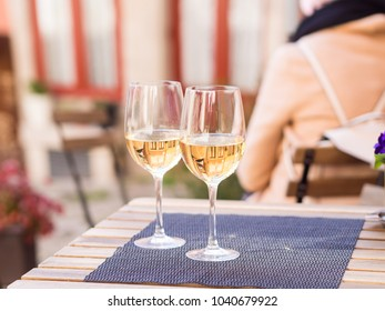 Two glasses of white wine served in a small cafe in the Old Town of Porto, Portugal.