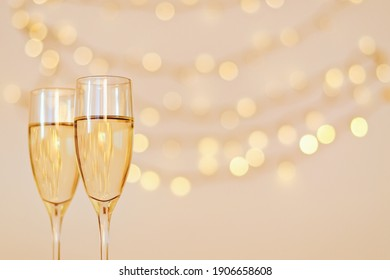 Two glasses of wine with bokeh background close up. Top view. New Year, Christmas mood. Greeting card. Party and holiday celebration concept.