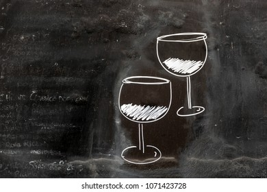 Two glasses of wine drawn with white chalk