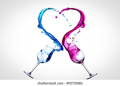 Two glasses of wine in free fall, colliding, forming a heart shape  - motion capture