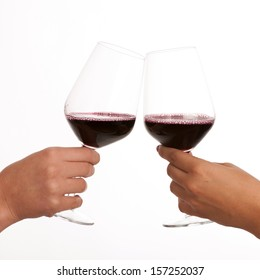 two glasses of wine in hands isolated over white