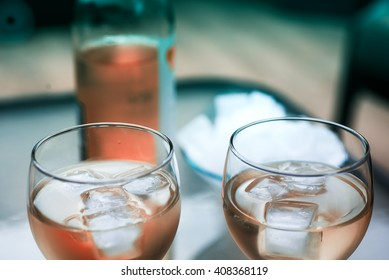 Two glasses of wine and ice