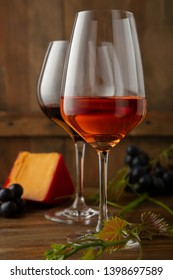 Two glasses of wine on wood
