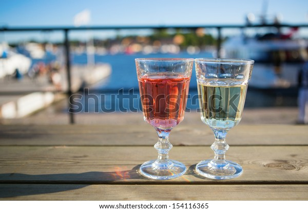Two glasses of wine in an outdoor cafe
