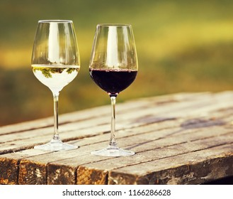 Two glasses of wine, red wine and white wine outdoor