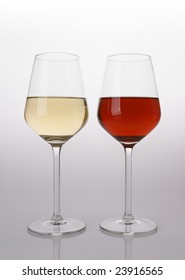 Two glasses of wine, red and white