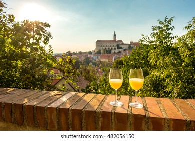 Two glasses of young wine (burcak) traditional drink at the end of summer and autumn when grapes are riped, Mikulov, South Moravia region, Czech Republic