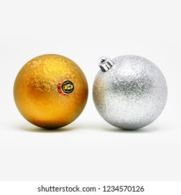 Two glittering Christmas tree decoration balls isolated on a white background