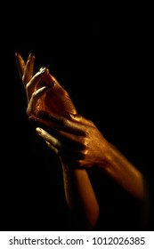 two gold hand on black background