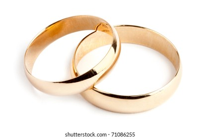 Two gold rings on white background