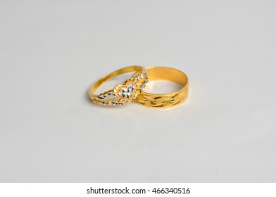 Two gold rings in white background