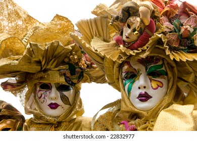 Two golden masks in Venice, Italy.