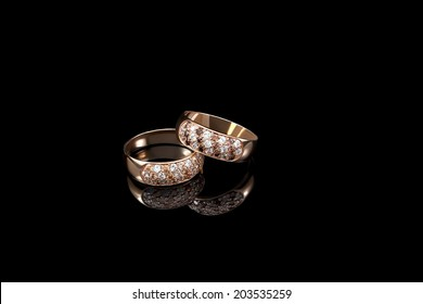 Two  golden rings on black background