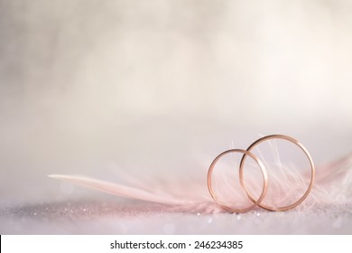 Two Golden Wedding Rings and  Feather - gentle soft background for marriage, retro toned