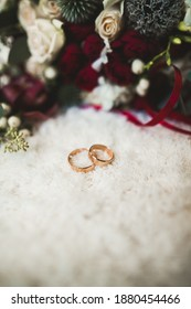 Two golden wedding rings isolated background concept