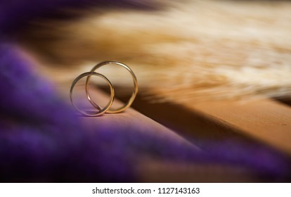 Two Golden Wedding Rings with purls on pillow
