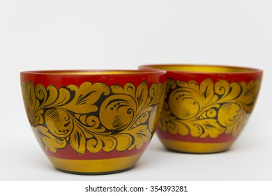 Two golden wooden bowl with a pattern.