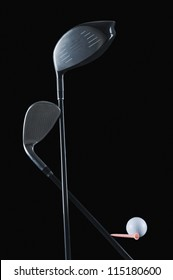 Two golf clubs with a golf ball