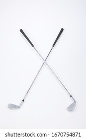 Two golf clubs of different colors