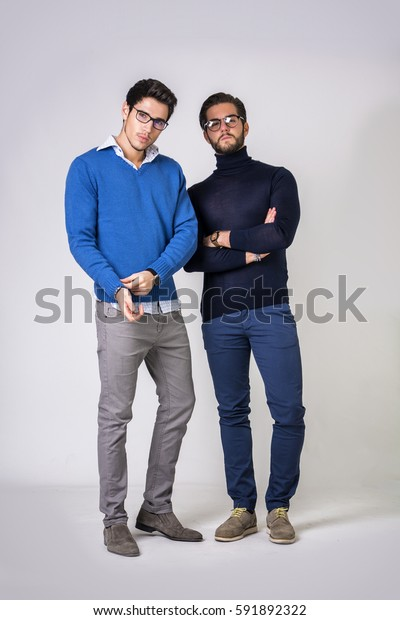 Two good-looking men in stylish clothes.Studio shot.