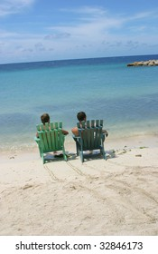Two guy's got themselves front row seats at mambo beach, Curacao.