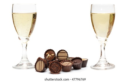 Two Graceful glasses for champagne and chocolate on the white