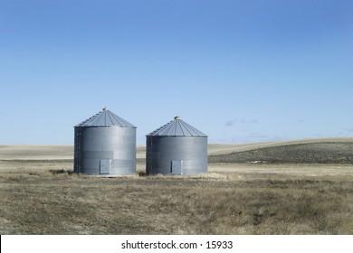 Two grain bins on the Prairies