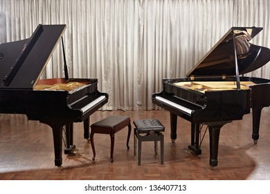 Two grand pianos on stage without no one