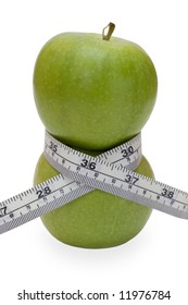 Two green apple with tape measure