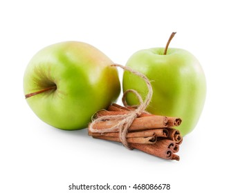 two green apples and cinnamon isolated on white background