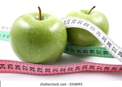 two green apples and measure isolated on white