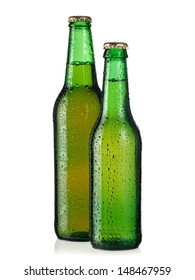 Two green beer bottles with drops