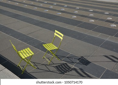 Two Green chairs facing each other