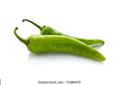 Two green chili on white background