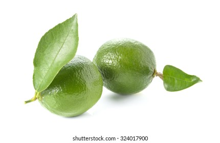 Two green lemon,leaves placed on wooden floor.